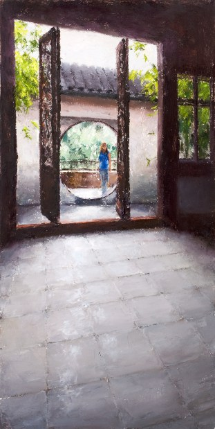 Oil painting of a woman seen from a distance through a round portal behind large carved, wooden doors in Suzhou, China.