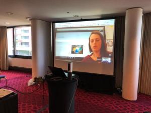 Photo of Laura on Screen at #FoL18 by Jon Fulton
