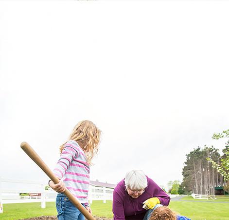 Image of a grandma and her grandkids gardening