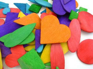 colored wooden shapes with hearts