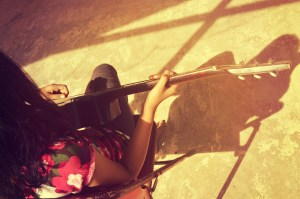 girl and her shadow playing guitar