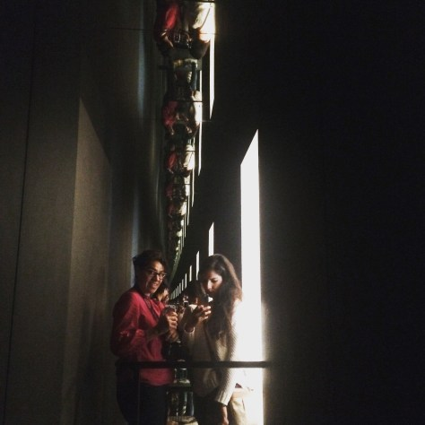 My sister and I just playing with mirrors in this installation by Olafur Eliasson.