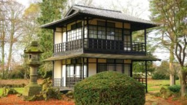 two story small wooden house