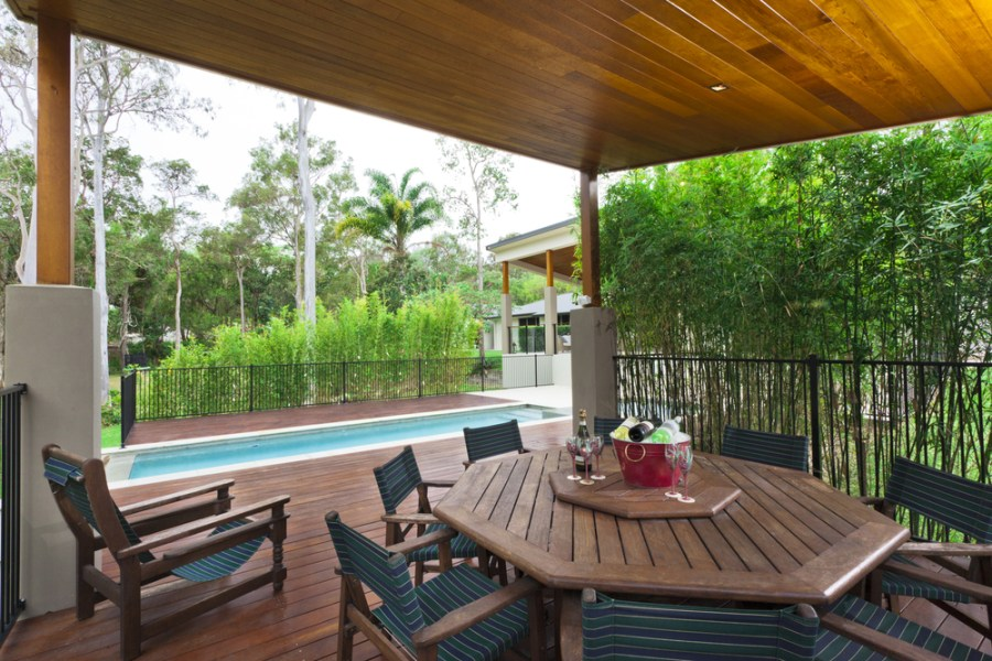 backyard dining area with pool