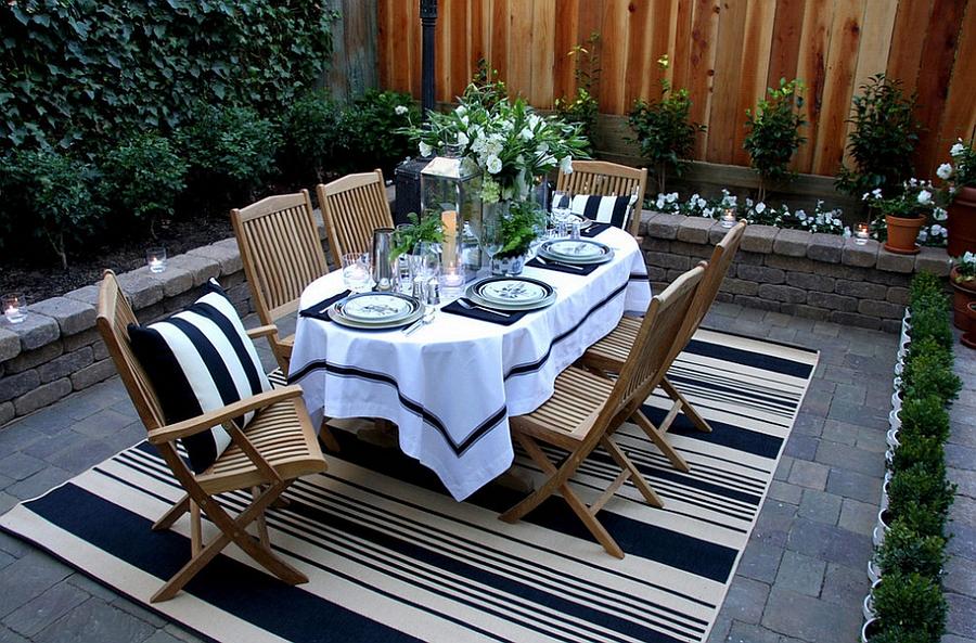 backyard dining area with rug