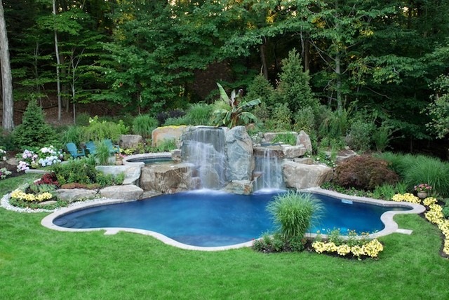 minimalist backyard waterfall with pond