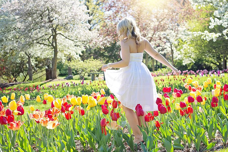 spring tulips pretty woman young woman flowers springtime female nature natural 1