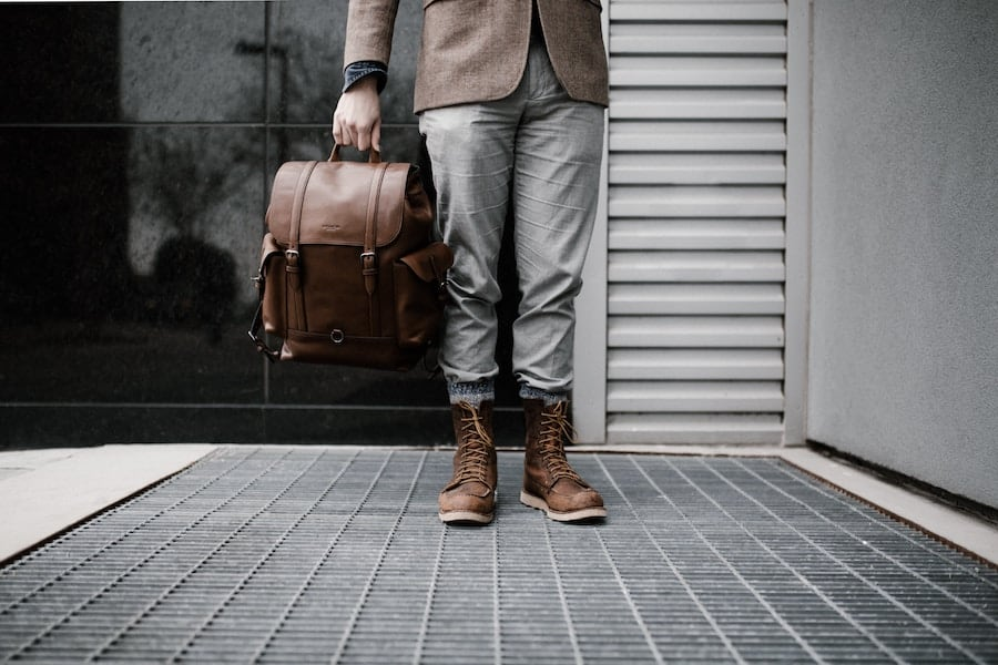Beautiful leather Backpack held by a fashionable man