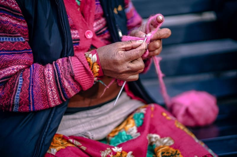 indian aunty weaving a scarf