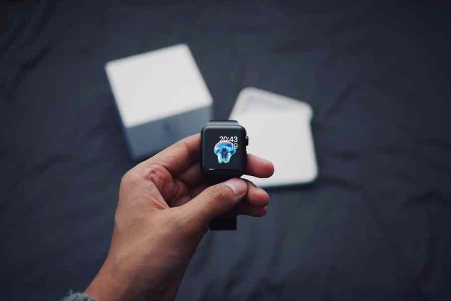 Hand holding a freshly opened Apple iWatch