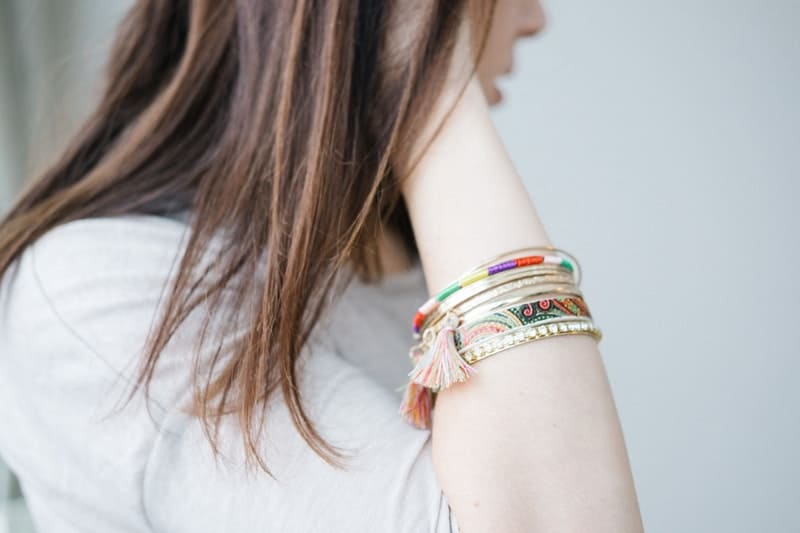 Young woman wearing pretty bracelets