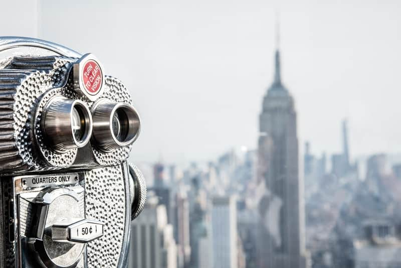 binoculars looking out on New York City during day