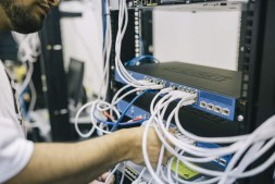 Man hooking up ethernet ports