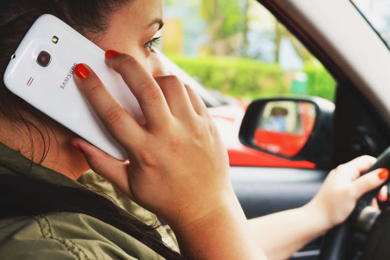 woman talking on her cell phone while driving