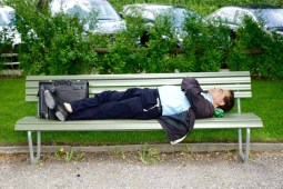 business man sleeping on a bench