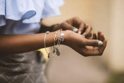 Selective Focus Photography of Person Wearing Three Bangles