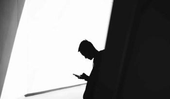 Teenager Using His Smartphone