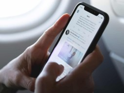 Man Checking his Twitter News Feed on The Plane