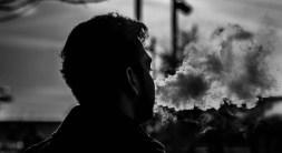 Man Smoking with a Vape Pen
