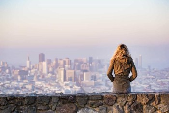 Woman Sitting on the Edge looking at the skyline