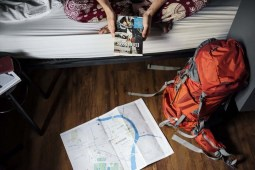 solo traveller following a lonely planet guide book
