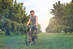 helthy man riding a bicycle