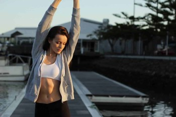 Beautiful Young Woman Strenching Her Arms