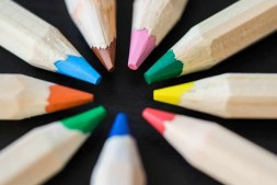 Colored Pencils in a Circle on a Black Desk