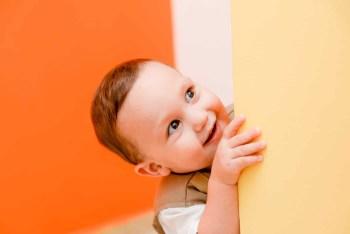 Cute Kid Peeking Around the Corner