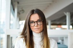Gorgeous Woman Wearing Reading Glasses with a White Sweater