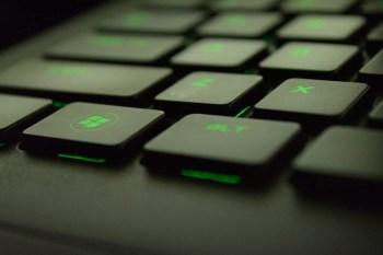 Windows Button on a Backlit Green Keyboard
