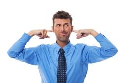 Man closing his ears