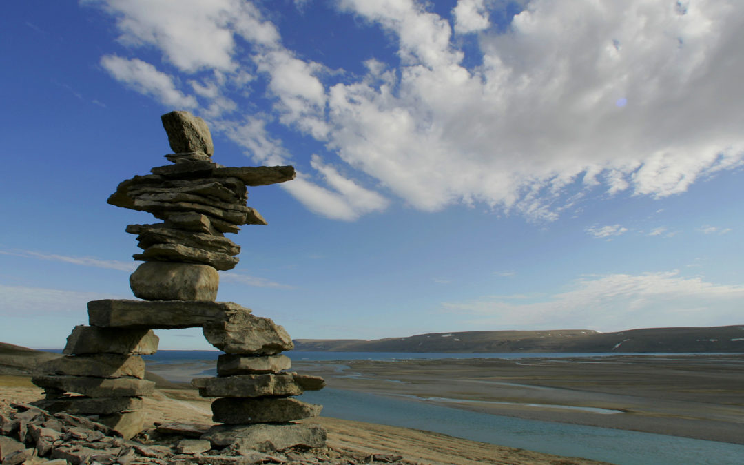 inuksuk-foreground-clouds-riverbed-1080x675