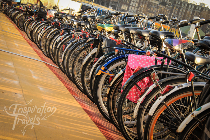 A bunch of bicycles in a row