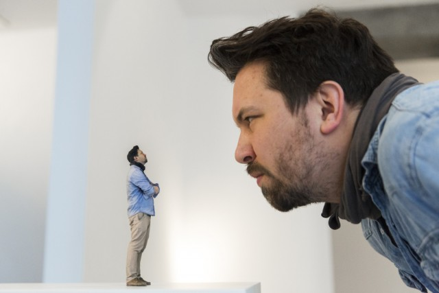Twinkind co-founder Schaedel looks at 3D-printed figure of himself at Twinkind 3D printing studio in Berlin