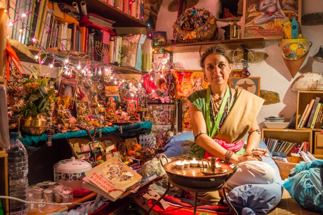 ITALY - JUNE 30: Indian style room and sitting indian women on June 30, 2015.