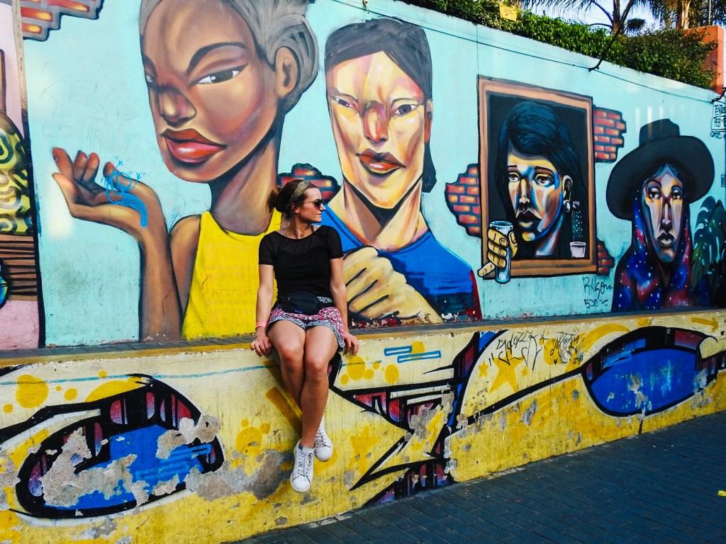 Girl behind graffiti street art, Barranco, Peru