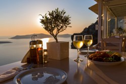 Romantic dinner for two on the island Santorini, Greece. Views of the sea and the volcano