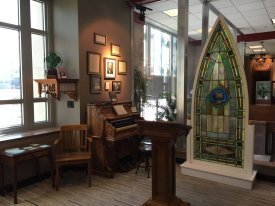 Replica of a Sunday School room with an organ and hymnals representing LifeWay's rich history not only in Sunday School curriculum but also in hymn writing.