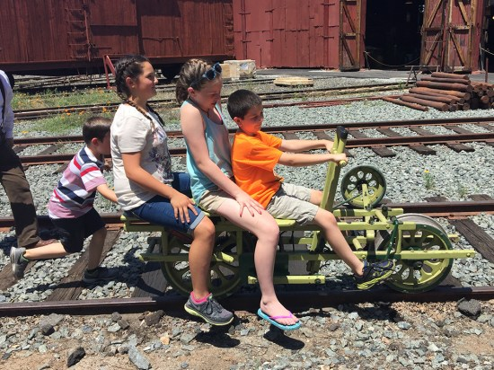 Kids Drive Velocipede Hand Car On the Tracks at Railtown