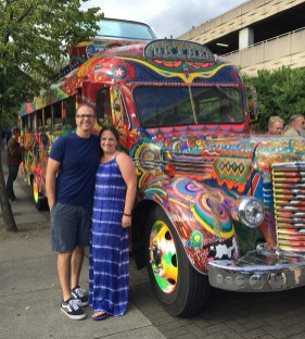 Brian Bourn and Jennifer Bourn In Front Of The Furthur Bus