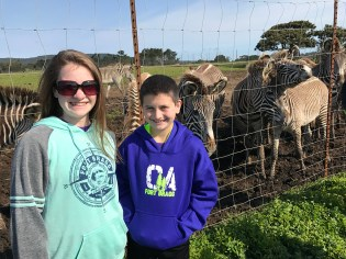Natalie and Carter Close Up With Zebras