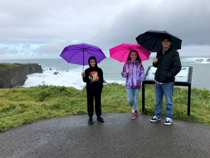 Family Overlooking the Pacific Ocean In The Rain At Pomo Bluffs Park