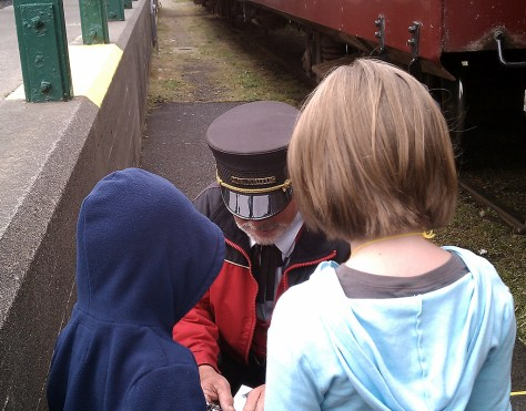 The Kids Getting Their Skunk Train Tickets Stamped