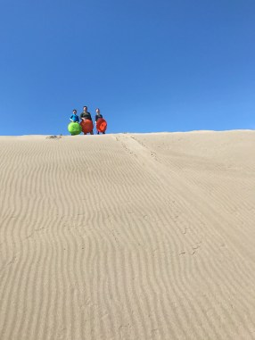 Sand Sledding With Snow Discs at Ten Mile Dunes