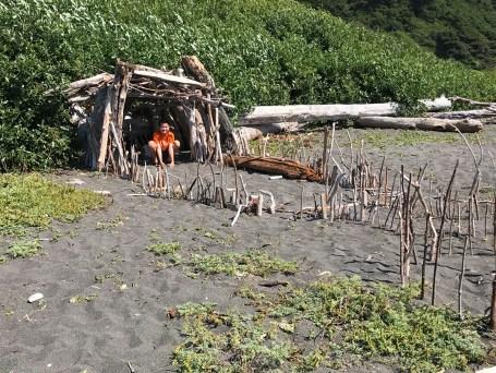 Carter Bourn inside a driftwood fort