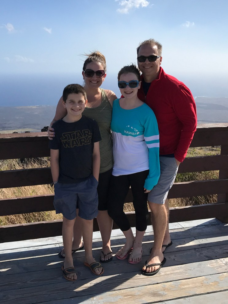 Bourn Family Standing on the at the Kealakomo Lookout