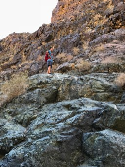 Carter Bourn Climbing Rocks In Death Valley National Park