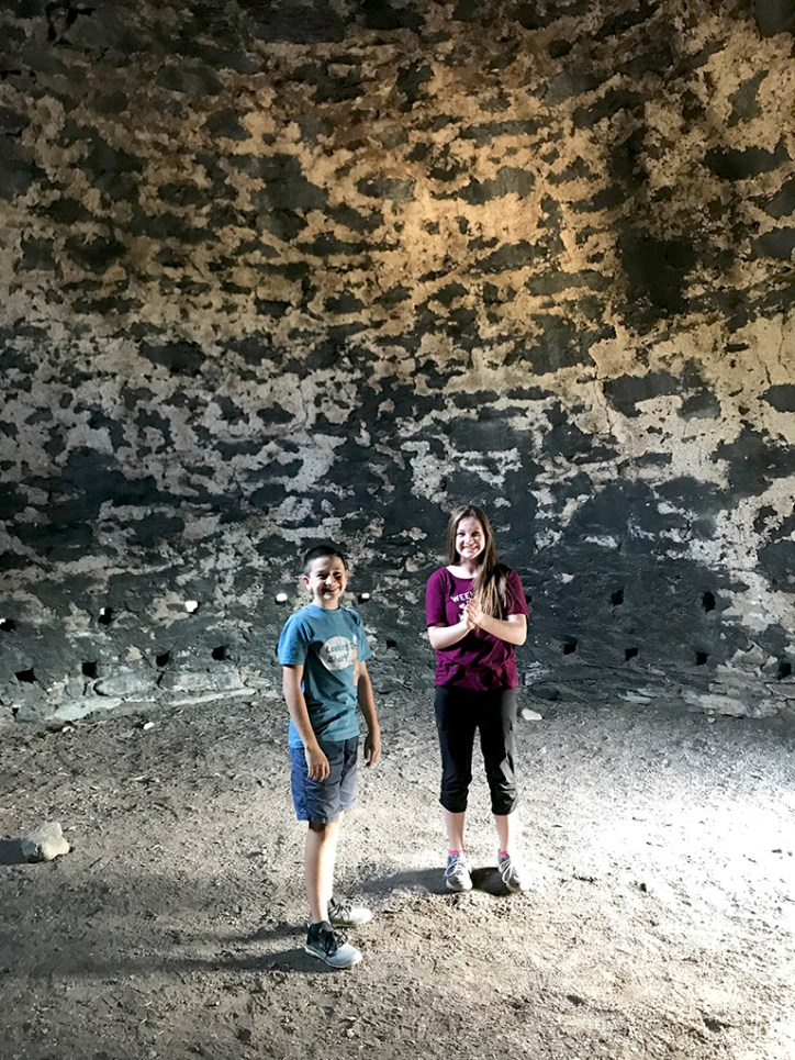 Natalie and Carter Bourn Inside a Beehive CHarcoal Kilns