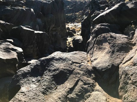 Looking Into Fossil Falls Canyon Lined With Carved Basalt Walls